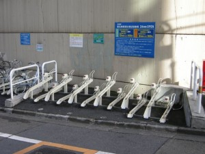 Not sure who thought this through.  The reason the bicycle parking is unused is (1) because it's inconveniently located away from the shops; and (2) nobody wants to pay 100 yen to pay for legal bike parking when in practice you can just chain your bike up anywhere you like.