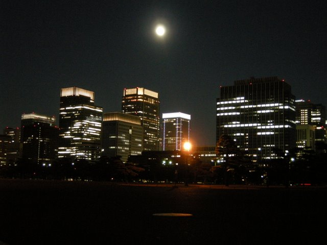 Full moon and the Marunouchi lights from outside the Imperial Palace